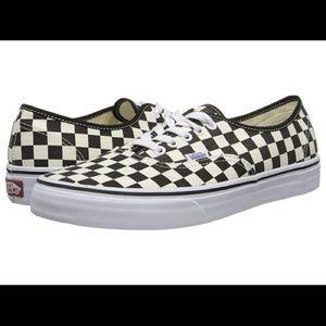 Black and white checker Vans
